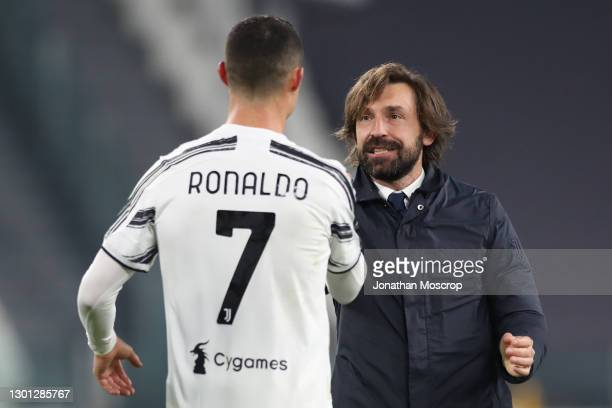Andrea Pirlo Head coach of Juventus embraces Cristiano Ronaldo of Juventus following the final whistle in the Coppa Italia semi-final between...