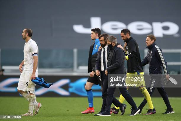 Andrea Pirlo Head coach of Juventus embraces Gabriele Oriali Internazionale First Team Technical Manager as they leave the field of play together...
