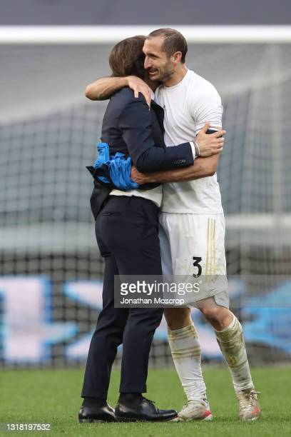 Andrea Pirlo Head coach of Juventus embraces Giorgio Chiellini of Juventus as the club's Champions League qualification remains alive following the...