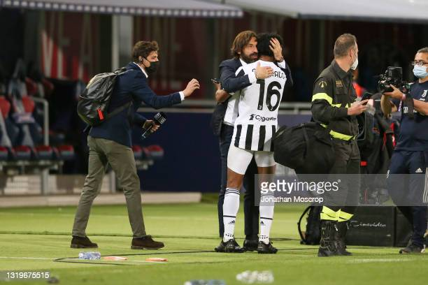 Andrea Pirlo Head coach of Juventus embraces Juan Cuadrado following the news from other grounds confirming the club's qualficiation for the...