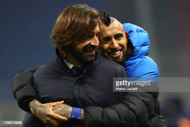 Andrea Pirlo, Head Coach of Juventus interacts with Arturo Vidal of Internazionale following the Serie A match between FC Internazionale and Juventus...