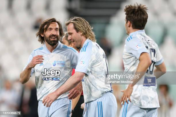 Andrea Pirlo Head coach of Juventus, Pavel Nedved Vice President of Juventus and Ferrari Formula One Pilot Charles Leclerc celebrate after the latter...