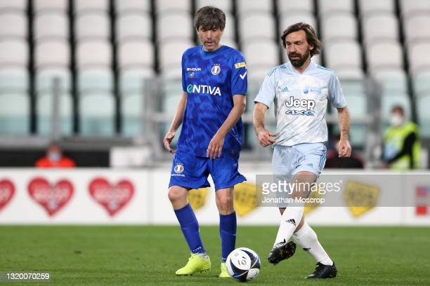 Andrea Pirlo, head coach of Juventus, plays the ball as Bugo, Italian singer-songwriter, artist and actor looks on during the 30th 'Partita Del...