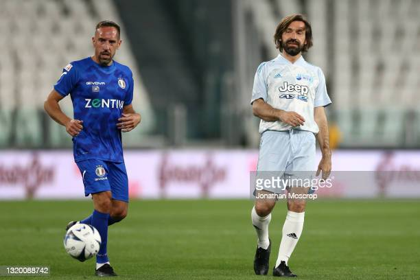 Andrea Pirlo Head coach of Juventus plays the ball as Franck Ribery looks on during the 30th 'Partita Del Cuore' charity friendly match between...