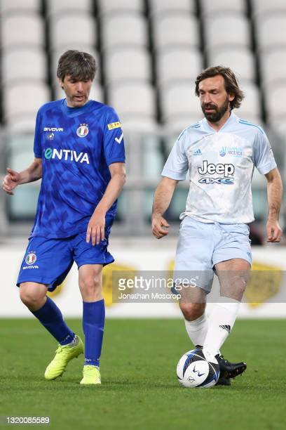 Andrea Pirlo Head coach of Juventus plays the ball as Italian Singer-Songwriter, Artist and Actor Bugo closes in during the 30th 'Partita Del Cuore'...