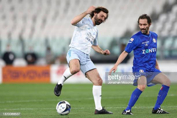 Andrea Pirlo Head coach of Juventus turns away from Boosta Singer of the group Subsonica, writer and television host during the 30th 'Partita Del...