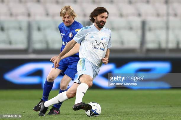 Andrea Pirlo, head coach of Juventus, turns away from Moreno Conficconi, Italian singer and musician, during the 30th 'Partita Del Cuore' charity...