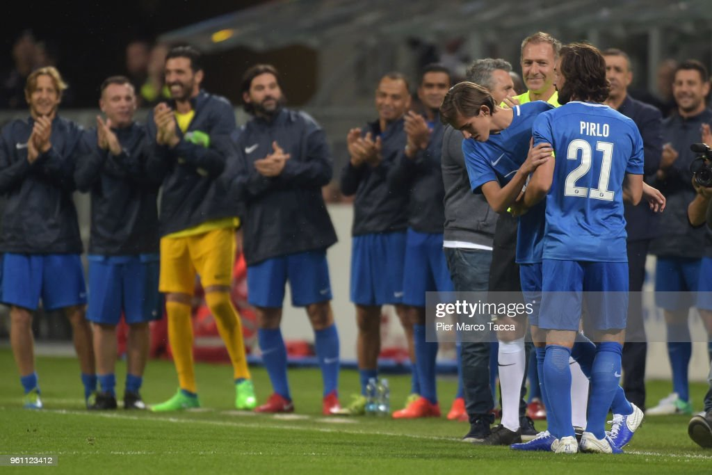 Andrea Pirlo leaves the field, his son Nicolo enters during Andrea Pirlo Farewell Match at Stadio Giuseppe Meazza on May 21, 2018 in Milan, Italy.