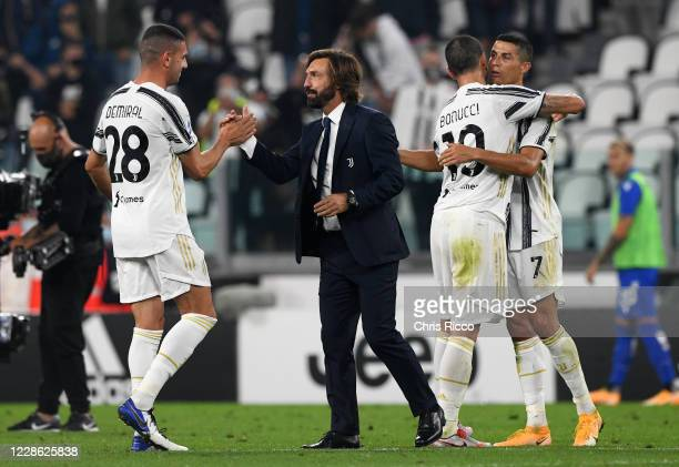 Andrea Pirlo Manager of Juventus celebrates win with players Merih Demiral of Juventus and Leonardo Bonucci of Juventus and Cristiano Ronaldo of...