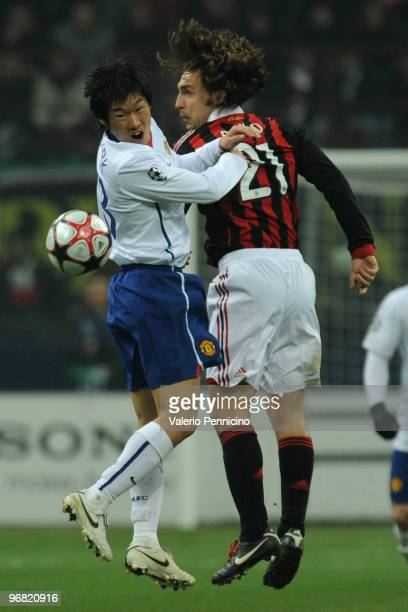 Andrea Pirlo of AC Milan clashes with Jisung Park of Manchester United during the UEFA Champions League round of 16 first leg match between AC Milan...
