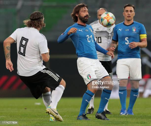 Andrea Pirlo of Azzurri Legends is challenged by Torsten Frings of DFBAllStars during the friendly match between DFBAllStars and Azzurri Legends at...