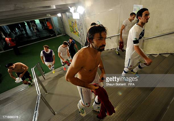 Andrea Pirlo of Italy and Alberto Aquilani head for the dressing room after losing a penalty shootout during the FIFA Confederations Cup Brazil 2013...