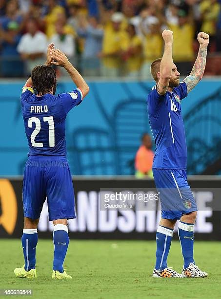 Andrea Pirlo of Italy and Daniele De Rossi acknowledge the fans after defeating England 21 during the 2014 FIFA World Cup Brazil Group D match...