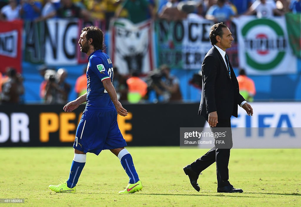 Andrea Pirlo of Italy and head coach Cesare Prandelli react after the 0-1 defeat in the 2014 FIFA World Cup Brazil Group D match between Italy and Uruguay at Estadio das Dunas on June 24, 2014 in Natal, Brazil.