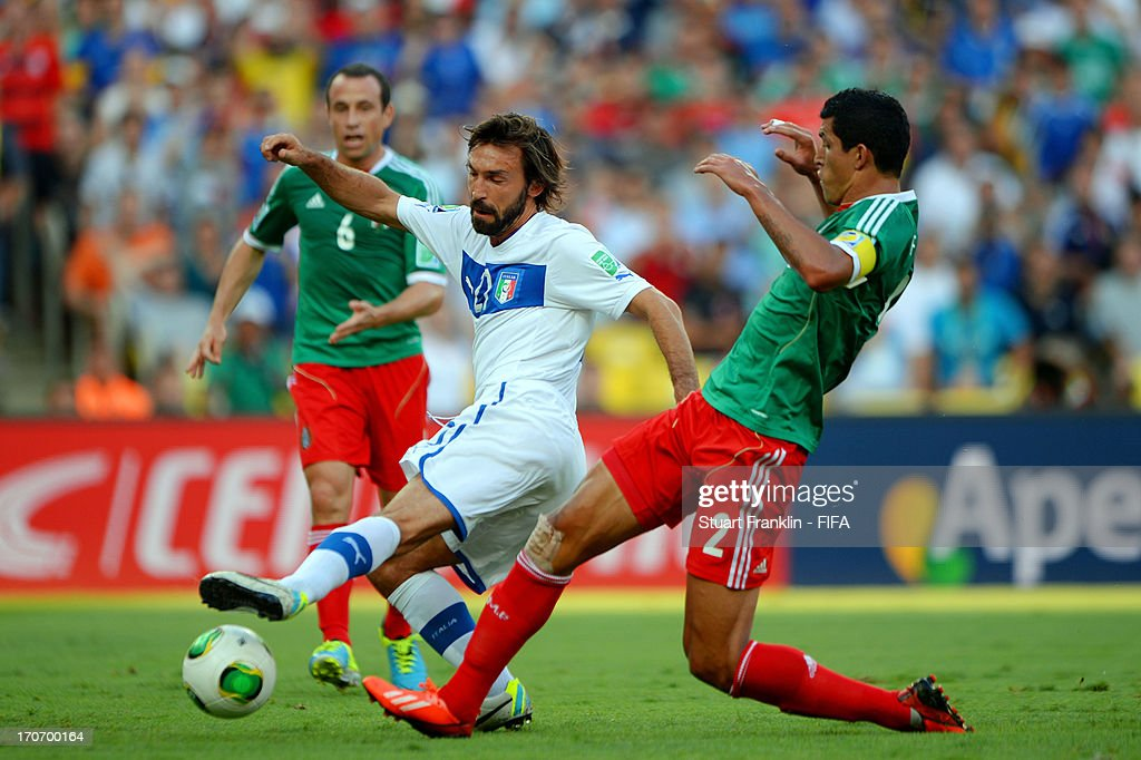 Andrea Pirlo of Italy is challenged by Francisco Javier Rodriguez of Mexico during the FIFA Confederations Cup Brazil 2013 Group A match between Mexico and Italy at the Maracana Stadium on June 16, 2013 in Rio de Janeiro, Brazil.