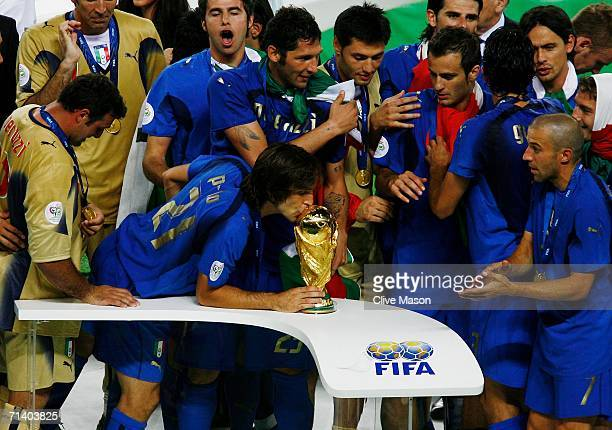 Andrea Pirlo of Italy kisses the World Cup trophy following his team's victory in a penalty shootout at the end of the FIFA World Cup Germany 2006...