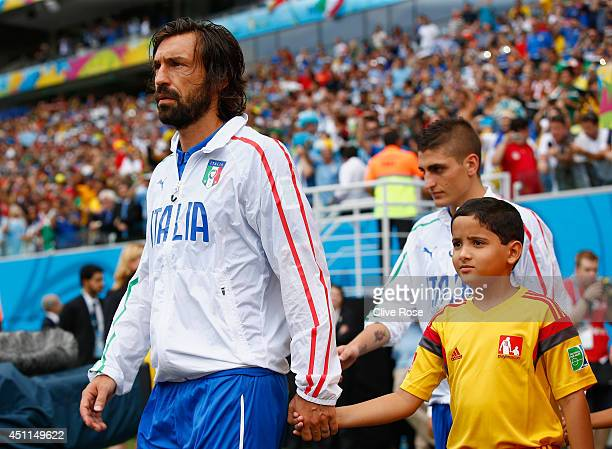 Andrea Pirlo of Italy leads his team into the pitch prior to the 2014 FIFA World Cup Brazil Group D match between Italy and Uruguay at Estadio das...