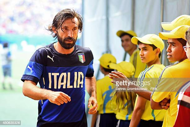 Andrea Pirlo of Italy leaves the pitch after warming up prior to the 2014 FIFA World Cup Brazil Group D match between England and Italy at Arena...