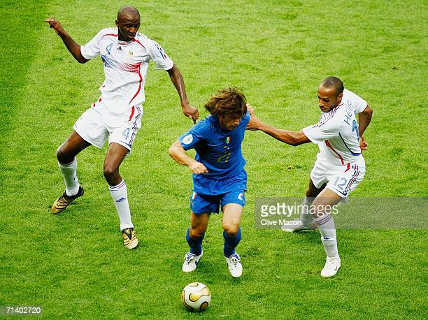 Andrea Pirlo of Italy moves away from Patrick Vieira of France and team mate Thierry Henry during the FIFA World Cup Germany 2006 Final match between...