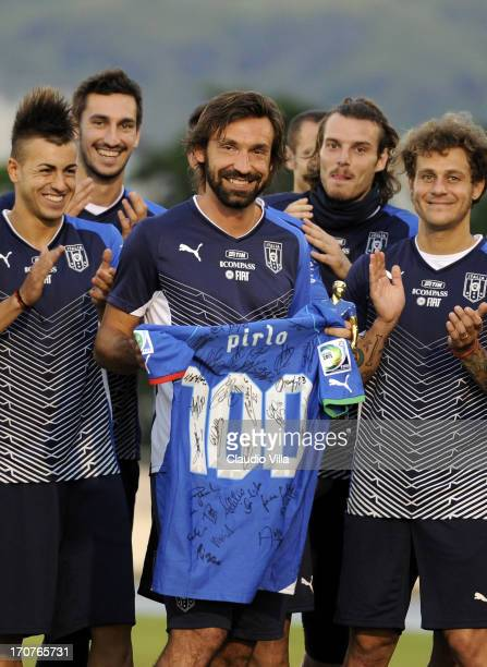 Andrea Pirlo of Italy receives a signed shirt from teammates during an Italy training session at Estadio Joao Havelange on June 17 2013 in Rio de...