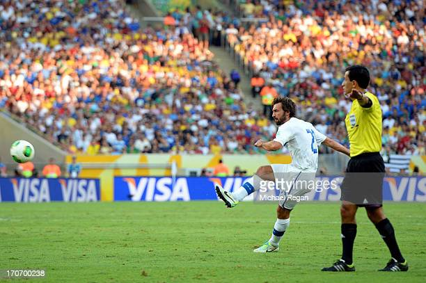 Andrea Pirlo of Italy scores the opening goal during the FIFA Confederations Cup Brazil 2013 Group A match between Mexico and Italy at the Maracana...