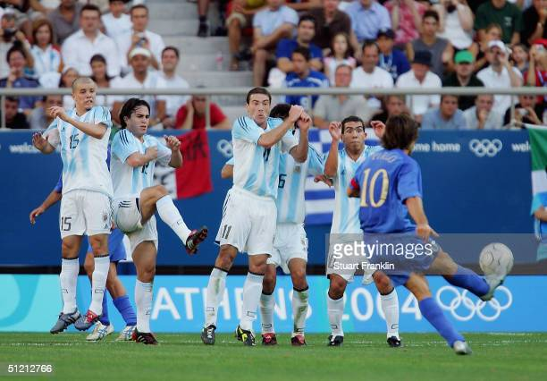 Andrea Pirlo of Italy shoots against the wall of players from Argentina during the men's football semifinal match on August 24 2004 during the Athens...