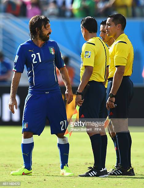 Andrea Pirlo of Italy speaks to referees after the 01 defeat in the 2014 FIFA World Cup Brazil Group D match between Italy and Uruguay at Estadio das...