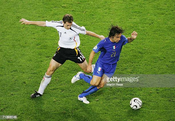 Andrea Pirlo of Italy takes the ball away from Miroslav Klose of Germany during the FIFA World Cup Germany 2006 Semifinal match between Germany and...