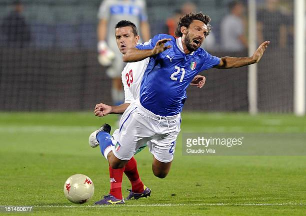 Andrea Pirlo of Itay falls in a challenge during the FIFA 2014 World Cup Qualifier group B match between Bulgaria and Italy at Vasil Levski National...