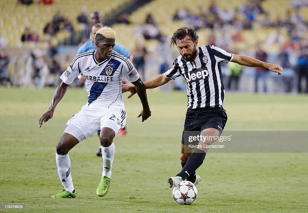 Andrea Pirlo #21 of Juventus and Gyasi Zardes #29 of the Los Angeles Galaxy battle for the ball during the second half of the 2013 Guinness International Champions Cup at Dodger Stadium on August 3, 2013 in Los Angeles, California
