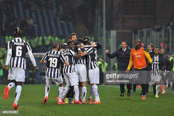 Andrea Pirlo of Juventus celebrates after scoring the opening goal with teammates during the Serie A match between Genoa CFC and Juventus at Stadio...
