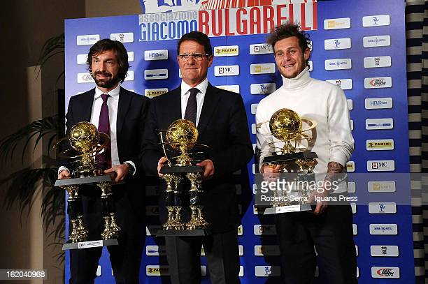 Andrea Pirlo of Juventus Fabio Capello and Alessandro Diamanti of Bologna FC pose with their awards at Hotel Savoyon February 18 2013 in Bologna Italy
