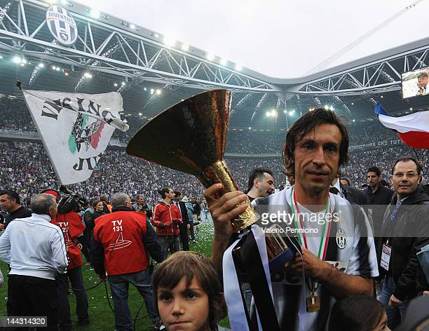 Andrea Pirlo of Juventus FC celebrates with the Serie A trophy after the Serie A match between Juventus FC and Atalanta BC at Juventus Stadium on May...