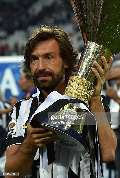 Andrea Pirlo of Juventus FC celebrates with the Serie A Trophy at the end of the Serie A match between Juventus FC and SSC Napoli at Juventus Arena...