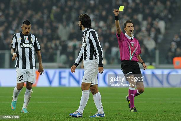 Andrea Pirlo of Juventus FC receives the yellow card from referee Paolo Tagliavento during the Serie A match between Juventus FC and FC...