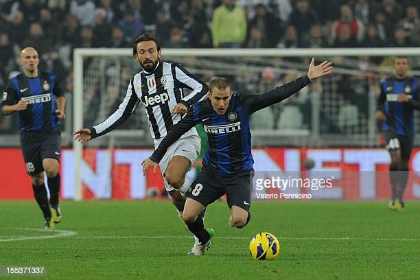 Andrea Pirlo of Juventus FC tacles Rodrigo Palacio of FC Internazionale Milano during the Serie A match between Juventus FC and FC Internazionale...