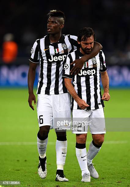 Andrea Pirlo of Juventus is consoled by Paul Pogba after the UEFA Champions League Final between Juventus and FC Barcelona at Olympiastadion on June...