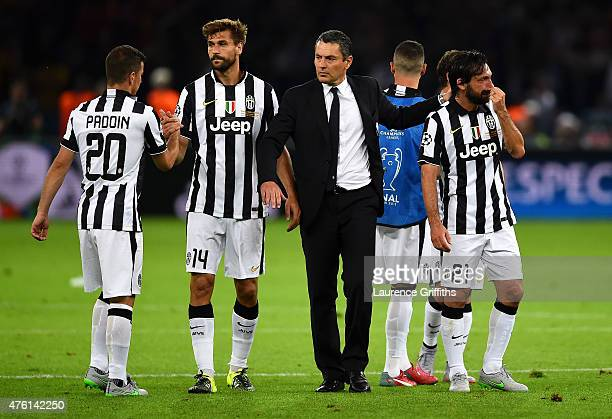 Andrea Pirlo of Juventus looks dejected alongside team mates after the UEFA Champions League Final between Juventus and FC Barcelona at...