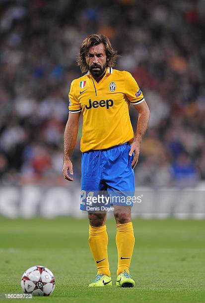 Andrea Pirlo of Juventus takes a free kick during the UEFA Champions League Group B match between Real Madrid CF and Juventus at Estadio Santiago...