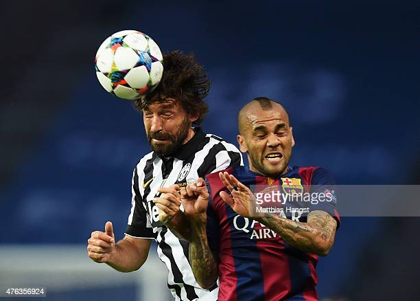 Andrea Pirlo of Juventus wins a header with Daniel Alves of Barcelona during the UEFA Champions League Final between Juventus and FC Barcelona at...