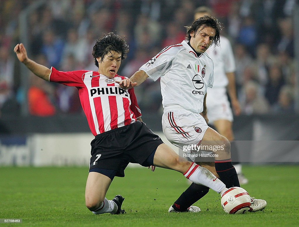 Andrea Pirlo of Milan challenges Ji Sung Park of PSV during the UEFA Champions League Semi Final, 2nd Leg, match between PSV Eindhoven and AC Milan, held at The Philips Stadion on May 4, 2005 in Eindhoven, Netherlands