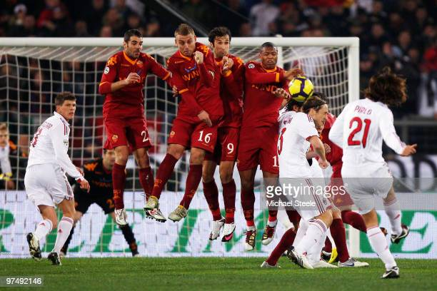 Andrea Pirlo of Milan curls a free kick over the Roma wall during the Serie A match between AS Roma and AC Milan at Stadio Olimpico on March 3 2010...
