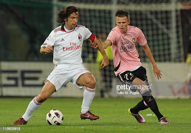 Andrea Pirlo of Milan is challenged by Josip Ilicic of Palermo during the Tim Cup between US Citta di Palermo and AC Milan at Stadio Renzo Barbera on...