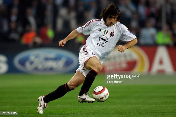 Andrea Pirlo of Milan runs with the ball during the Champions League semi final second Leg match between PSV Eindhoven and AC Mailand at the Philips...