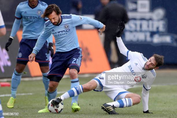 Andrea Pirlo of New York City FC is challenged by Ignacio Piatti of Montreal Impact during the New York City FC Vs Montreal Impact regular season MLS...