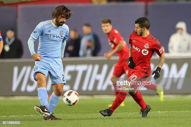 Andrea Pirlo of New York City FC is challenged by Sebastian Giovinco of Toronto FC in action during the NYCFC Vs Toronto FC MLS playoff game at...
