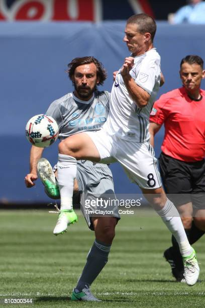 Andrea Pirlo of New York City FC is challenged by Will Johnson of Orlando City SC during the New York City FC Vs Orlando City SC regular season MLS...