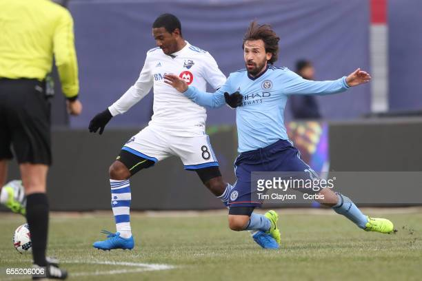 Andrea Pirlo of New York City FC is pushed off the ball by Patrice Bernier of Montreal Impact during the New York City FC Vs Montreal Impact regular...