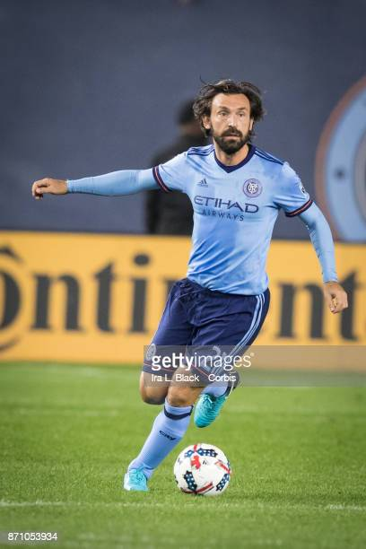 Andrea Pirlo of New York City FC looks for a teammate to pass to during the Audi MLS Eastern Conference Semifinal Leg 2 match between New York City...