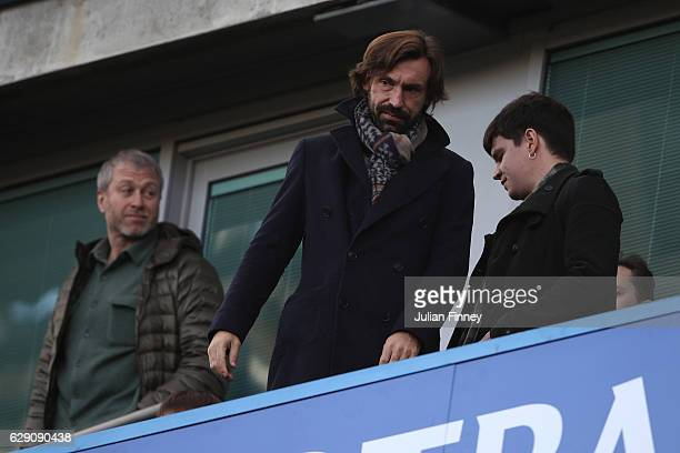 Andrea Pirlo of the New York City and Chelsea owner Roman Abramovich are seen in the stand prior to the Premier League match between Chelsea and West...